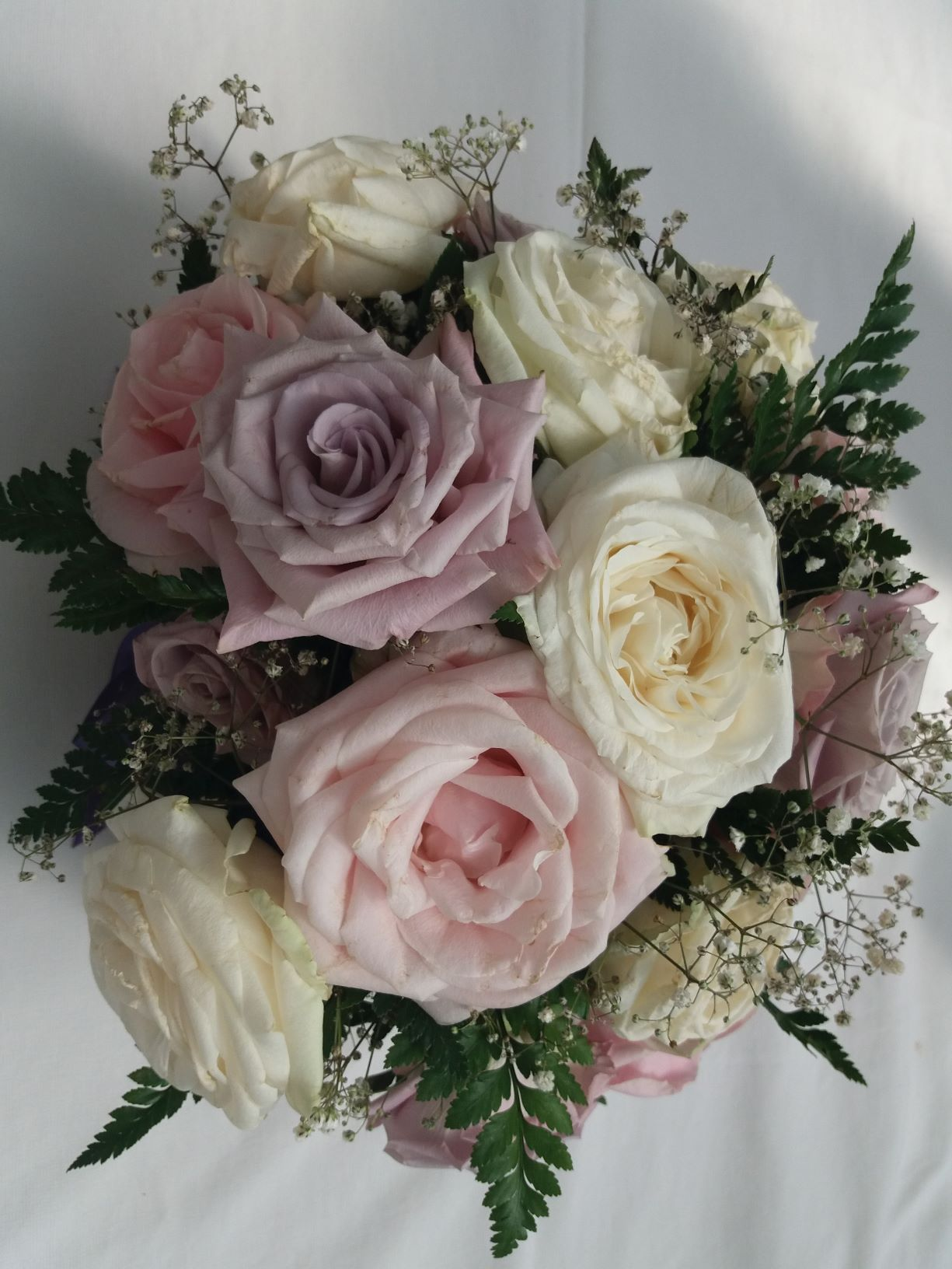 Pink, cream, lilac roses display
