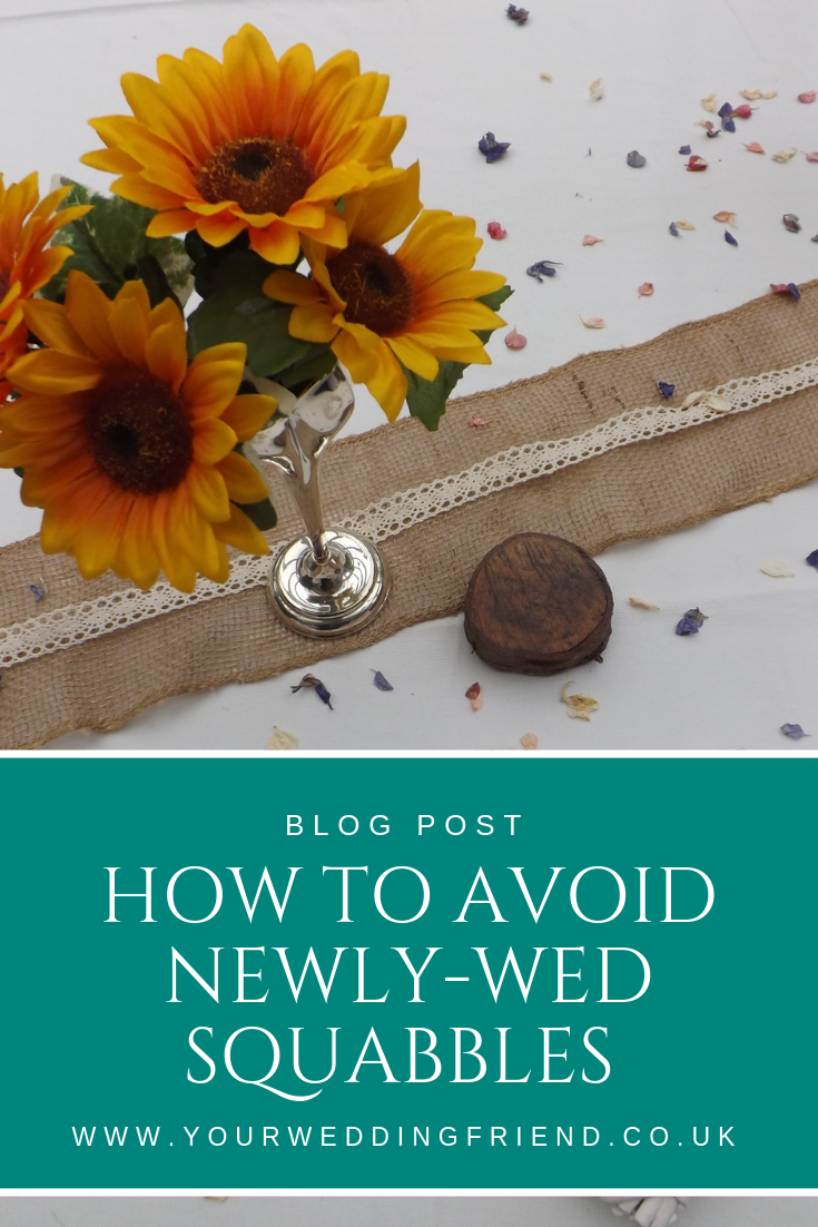 How to avoid newly-wed squabbles with a picture of some sunflowers in a silver vase on a white table cloth with a hessian table runner