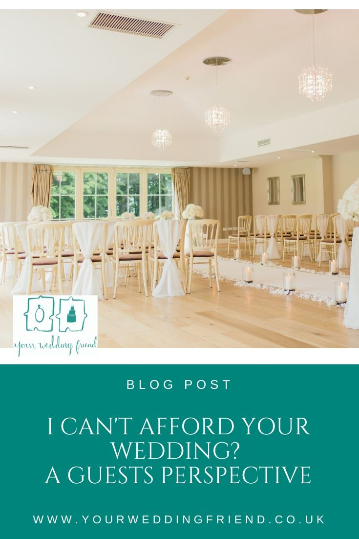 The image shows a wedding ceremony room set up with white chivari chairs and every other chair has a white chiffon drape tied to it. The room also has a white aisle carpet over pine wood floor. The ceiling is low and painted white and has 3 small crystal